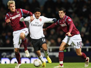 West-Ham-v-Arsenal-Carlos-Vela-between-Radosl_2403199