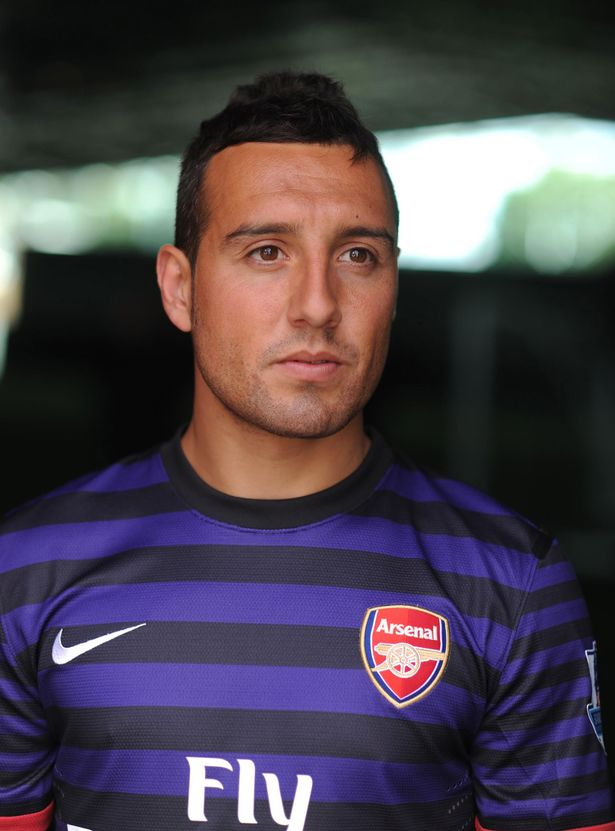 New+Arsenal+signing+Santi+Cazorla+poses+at+Arsenal+Training+Ground